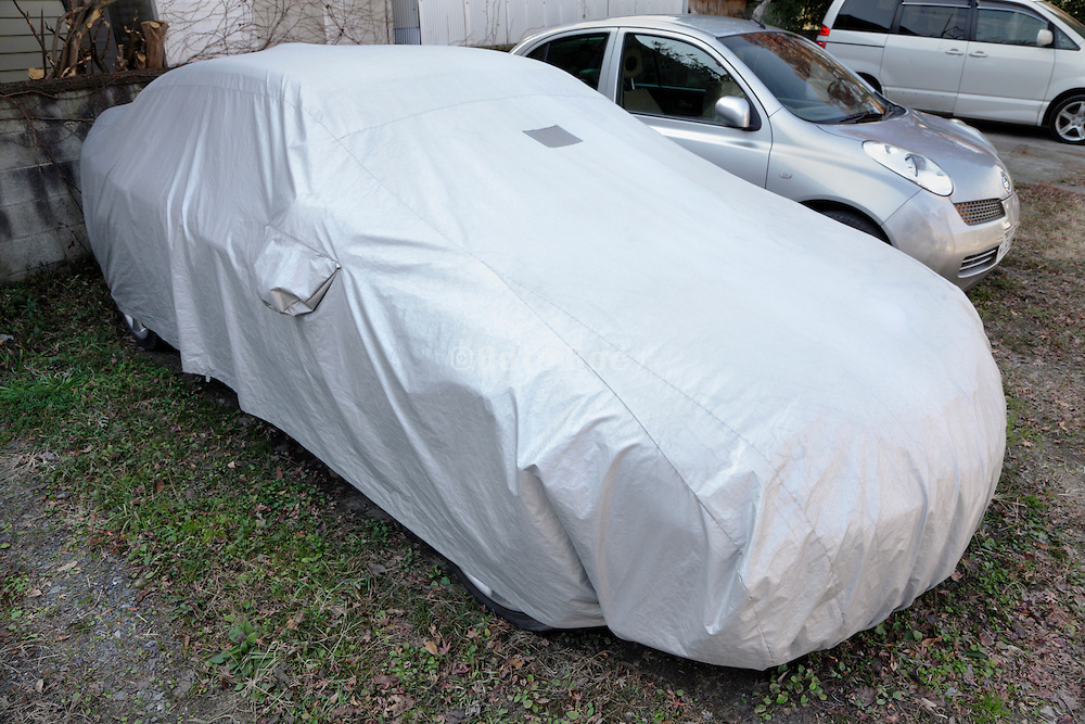 parked car with protective cover