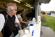 The owner of Vinnie's Diner, a roadside transport cafe along the busy A12, looks out onto passing traffic on the 21st October 2009 in Inworth in the United Kingdom.