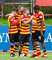 Partick Thistle Andrea Mbuyi-Mutombo (right) celebrates scoring his side's first goal of the game during the Betfed Cup Second Round match at the Energy Check Stadium at Firhill, Glasgow.