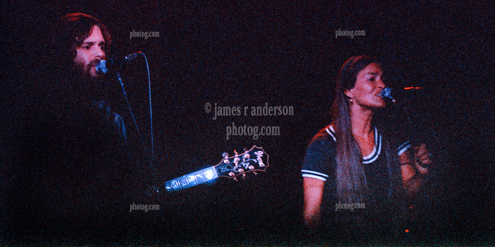 Bob Weir and Donna Jean Godchaux performing with The Grateful Dead. Live in Concert at The Springfield Civic Center on 23 April 1977. Solo Shot in Bright Blue Light.