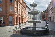 Children cycle in circles around the fountain on Novi Square in the Slovenian capital, Ljubljana, on 25th June 2018, in Ljubljana, Slovenia.