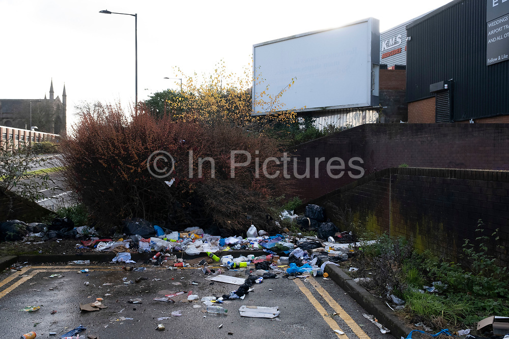 Fly tipped waste on the street in Highgate close to the city centre on 14th December 2020 in Birmingham, United Kingdom. Illegal dumping, also called fly dumping or fly tipping, is the dumping of waste illegally instead of using an authorised method such as kerbside collection or using an authorised rubbish dump. It is the illegal deposit of any waste onto land, including waste dumped or tipped on a site with no licence to accept waste.