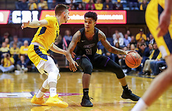 Mar 20, 2019; Morgantown, WV, USA; Grand Canyon Antelopes guard Damari Milstead (11) dribbles while defended by West Virginia Mountaineers guard Jordan McCabe (5) during the first half at WVU Coliseum. Mandatory Credit: Ben Queen