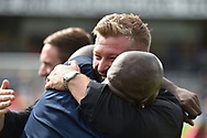 Oxford United manager Karl Robinson hugs Wycombe Wanderers striker Adebayo Akinfenwa (20) during the EFL Sky Bet League 1 match between Wycombe Wanderers and Oxford United at Adams Park, High Wycombe, England on 15 September 2018.