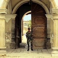 Central America, Guatemala, Antigua. A military guard at a government building in Antigua, Guatemala.