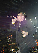 """Lead singer of U2 and  political activist Bono performs prior to the Atlanta Falcons-New Orleans Saints football game at the newly re-opened Louisiana Superdome in New Orleans, LA. on Monday, Sept. 25, 2006. Bono sang """"it's a Beautiful Day"""" to the sold out arena.(Photo/Suzi Altman)"""