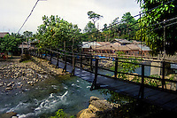 Indonesia, Sumatra. Bukit Lawang. There are several bridges like this one which you have to use to cross the river.