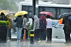 May 6, 2018 - Ankara, Turkey - Young people wait in line to attend a festival during a heavy rainfall in the Sogutozu district of Ankara, Turkey on May 6, 2018. (Credit Image: © Altan Gocher/NurPhoto via ZUMA Press)