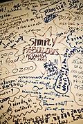 Reviews on a whiteboard at Raya Thai Cuisine restaurant, Phuket Old Town