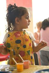 Nursery School girl in art lesson,
