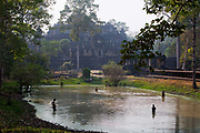 Boys fishing in the lake by the Baphuon Temple, Ankor Thom
