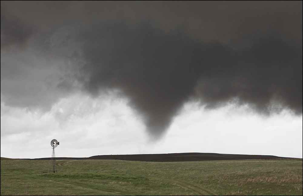 Isolated tornado in Lincoln County Kansas next to an old windmill.
