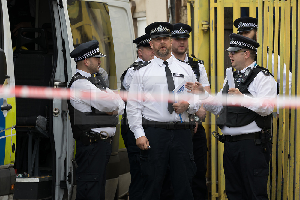 © Licensed to London News Pictures. 05/06/2017. LONDON, UK.  Police officers and vans outside an address on Ripple Road in Dagenham. Police carried out a raid at a Dagenham address early this morning in connection with the London Bridge terror attacks and residents reported hearing gun shots.  Photo credit: Vickie Flores/LNP