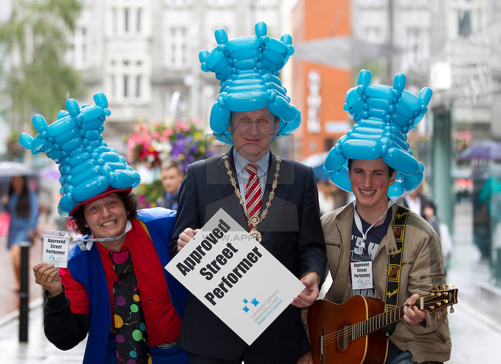 No fee for Repro: 30/07/2012 Cllr Gerry Breen is pictured with street performers Mr Balloonatic (left) and Aidan Malloy at the launch of a voluntary code of practice for Dublin's Street Performers developed with Dublin City Council and local traders. Pic Andres Poveda
