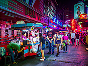 27 FEBRUARY 2019 - BANGKOK, THAILAND: Customers at a food stall on Soi Cowboy, one of Bangkok's adult entertainment districts. Bangkok, a city of about 14 million, is famous for its raucous nightlife. But Bangkok's real nightlife is seen in its markets and street stalls, many of which are open through the night.       PHOTO BY JACK KURTZ