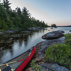 A canoe on the shore of Bald Mountain Pond at sunrise. Bald Mountain Township, Maine.