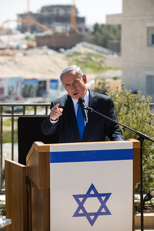 Israeli Prime Minister Benjamin Netanyahu delivers a statement in front of new construction during a visit to Har Homa, east Jerusalem, an area of the West Bank that Israel captured in a 1967 war and annexed to the city of Jerusalem, on March 16, 2015, a day ahead of legislative elections. Netanyahu, who is seeking his fourth term as prime minister said on Monday that as long as he remains Israel's leader, a Palestinian state would not be established.