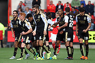 Tom Smith of Swindon Town celebrates with his teammates after scoring his teams 1st goal. Skybet football league 1 match, Crewe Alexandra v Swindon Town at The Alexandra Stadium in Crewe, Cheshire on Saturday 5th September 2015.<br /> pic by Chris Stading, Andrew Orchard sports photography.