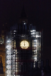 © Licensed to London News Pictures. 01/01/2018. London, UK. Big Ben strikes midnight just before a spectacular fireworks display lighting up the London skyline just after midnight on January 1, 2018 in central London as part of the capitals New Year's Eve celebrations. Thousands of people lined the banks of the River Thames in London to see in the New Year. Photo credit: Ray Tang/LNP