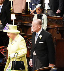 Doria Ragland watches the arrival of the Queen and the Duke of Edinurgh at St George's Chapel ahead of the wedding of her daughter Meghan Markle to Prince Harry.