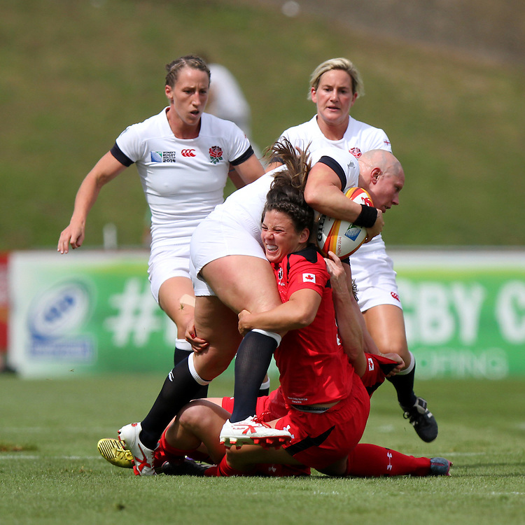 Heather Fisher tackled. England v Canada Pool A match at WRWC 2014 at Centre National de Rugby, Marcoussis, France, on 9th August 2014