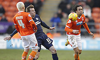 Blackpool's Nathan Delfouneso and David Perkins in action with Millwall's Martyn Woolford<br /> <br /> Photographer Mick Walker/CameraSport<br /> <br /> Football - The Football League Sky Bet Championship - Blackpool v Millwall - Saturday 10th January 2015 - Bloomfield Road - Blackpool <br /> <br /> © CameraSport - 43 Linden Ave. Countesthorpe. Leicester. England. LE8 5PG - Tel: +44 (0) 116 277 4147 - admin@camerasport.com - www.camerasport.com