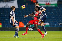 Bafetibis Gomis of Swansea City and Gareth McAuley of West Brom compete for the ball - Photo mandatory by-line: Rogan Thomson/JMP - 07966 386802 - 11/02/2015 - SPORT - FOOTBALL - West Bromwich, England - The Hawthorns - West Bromwich Albion v Swansea City - Barclays Premier League.