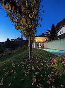 Beautiful modern house by night, garden and swimming pool