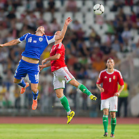 Israel's Tomer Hemed (L) and Hungary's Jozsef Varga (R) jump for a header during a friendly football match Hungary playing against Israel in Budapest, Hungary on August 15, 2012. ATTILA VOLGYI