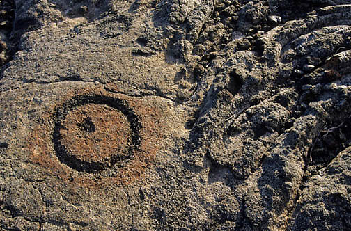 Hawaii Volcanoes National Park, Hawaiian petroglyphs or stone carvings in lava rock. Hawaii