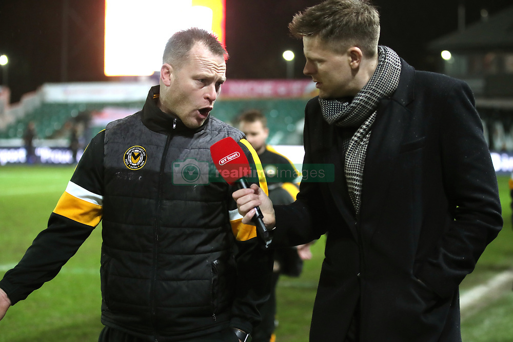Jake Humphrey (right) interviews Newport County manager Michael Flynn during half time