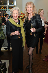 Left to right, PHYLLIS CUNNINGHAM and DEBBIE MOORE at a dinner in honour of Veuve Clicquot Business Woman Award UK Previous Winners held at Moet Hennessy, 18 Grosvenor Gardens, London on 8th April 2014.