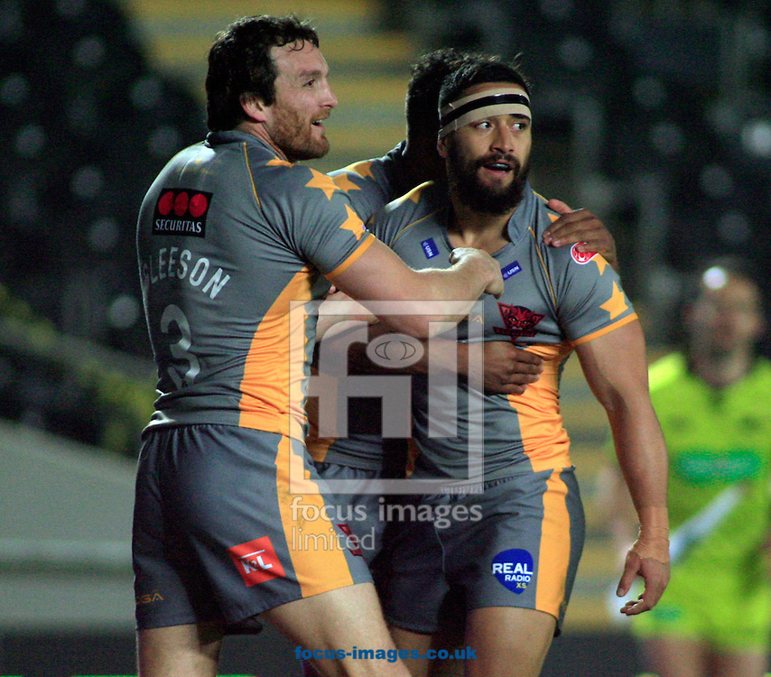 Rangi Chase (headbandage) of Salford Red Devils celebrates with his team mates during the Tetley's Challenge Cup match at the KC Stadium, Kingston upon Hull<br /> Picture by Richard Gould/Focus Images Ltd +44 7855 403186<br /> 03/04/2014