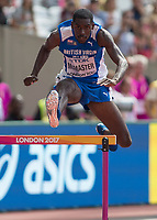 Athletics - 2017 IAAF London World Athletics Championships - Day Three, Morning Session<br /> <br /> 400m Hurdles Men - Round One<br /> <br /> Kyron McMaster (United States) clears the hurdle at the London Stadium <br /> <br /> COLORSPORT/DANIEL BEARHAM