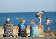 Group of people relaxing on seacoast, Paphos, Cyprus
