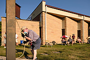 23 AUGUST 2020 - WEST DES MOINES, IOWA: A man rings the bell for the victims of COVID-19 at West Des Moines United Methodist Church. More than 100 people attended a memorial service at the church for Iowans who have died from COVID-19. Iowa is one of the Midwestern states that has recorded an increasing number of COVID-19 infections. Since Friday, August 21, Iowa has recorded 1,448 new cases of COVID-19. More than 1,030 Iowans have died from COVID-19, the disease caused by the Novel Coronavirus (SARS-CoV-2) since the pandemic hit Iowa in March.        PHOTO BY JACK KURTZ