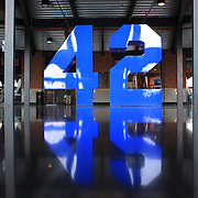 Jackie Robinson's number 42 sculpture inside the entrance to Citi Field during the New York Mets V San Francisco Giants Baseball game at Citi Field, Queens, New York. 21st April 2012. Photo Tim Clayton