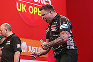 Gerwyn Price hits a double and celebrates beating Devon Petersen during the Ladbrokes UK Open Darts 2021 at stadium:mk, Milton Keynes, England. UK on 7 March 2021.