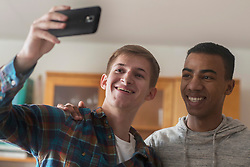 Friends taking self portrait with smart phone