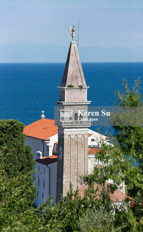 St George Church and red roofed houses along Adriatic coast, Piran, Slovenia