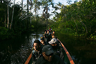All is silent except the sound of the water against the boat as the Frank Ski group floats through the jungle.