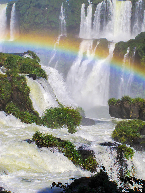 The natural wonder of the Iguazú Falls bordering Argentina and Brazil with a rainbow