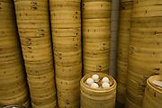 Dumpling in bamboo baskets awaiting steaming at a dumpling restaurant in Teipei, Taiwan.