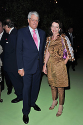 DR & MRS GERT-RUDOLF FLICK at a dinner hosted by Cartier in celebration of the Chelsea Flower Show held at Battersea Power Station, 188 Kirtling Street, London SW8 on 23rd May 2011.