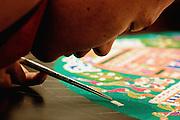 April 23, 2009 - Santa Barbara, CA: Universe of a Deity: A Tibetan Sand Mandala.  Monks from the Drepung Loseling Monastery work publicly inside the University Art Museum to create a detailed sand mandala, a symbolic representation of the universe.  University of California, Santa Barbara.  (Photo by Rod Rolle), April 23, 2009 - Santa Barbara, CA: Universe of a Deity: A Tibetan Sand Mandala.  Monks from the Drepung Loseling Monastery work publicly inside the University Art Museum to create a detailed sand mandala, a symbolic representation of the universe.  University of California, Santa Barbara.  (Photo by Rod Rolle)
