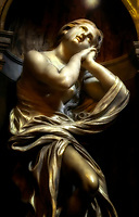 """""""Saint Mary Magdalene - Chigi Chapel of Siena Cathedral""""…<br /> <br /> The Duomo in Siena lies in a piazza above the Piazza del Campo, a great Gothic building filled with treasures by Pisano, Donatello, Bernini, and Michelangelo as well as frescoes by Pinturicchio. Originally completed in 1263, the 14th century inspired an ambitious attempt to transform the cathedral into the largest temple in all of Christendom, which would dwarf even St. Peter's in Rome. The already-large Duomo would form just the transept of this huge cathedral. In 1348, the Black Death swept through the city and killed 4/5 of Siena's population. The giant cathedral was never completed, and the half-finished walls of the New Cathedral survive as a monument to Siena's ambition and one-time wealth. The magnificent complex of the Cathedral of Siena houses a series of some of the most important monuments of the European artistic panorama. One will travel along a memorable itinerary to the discovery of self and the truth of faith through culture and art, the result of more than a millennium of Western history. If I was asked to choose only one place that represented the great history of art, architecture, culture, and faith in all of Italy…one would be hard-pressed to find a more complete portfolio than the Cathedral of Siena. I found myself awe-inspired just walking up and facing the elegant façade, striped walls and pillars, and massive size. Upon entering the nave, one is overwhelmed with a plethora of artistic expression and great beauty placed in every available space. From its dome, stained glass, frescos, sculptures, and to what is said to be the most magnificent marble floor in history…it is worth every minute. Saints Jerome and Mary Magdalene are sculptures by the great Italian artist Gianlorenzo Bernini. Work began on the sculptures in 1661 and now reside in the Chigi Chapel of the Siena Cathedral."""