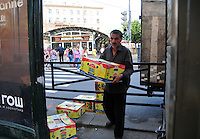 Fresh fruit means hard work for this metro stop vendor in St. Petersburg, Russia.