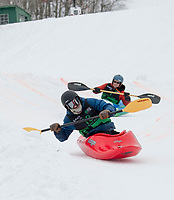 Christopher Freeman gets a jump on Jeremy Laucks as they head into the final turn during the semi final rounds of the 3rd annual Boat and Bash at Veteran's Memorial Ski Hill on Saturday afternoon.  (Karen Bobotas/for the Laconia Daily Sun)