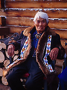 Chief Walter Northway, T'aiy Ta', world's oldest living man at the age of 115 on the porch of his log home, August, 1991, Northway, Alaska.