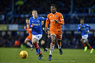 Blackpool Defender, Marc Bola (27) and Portsmouth Midfielder, Andy Cannon (14) during the EFL Sky Bet League 1 match between Portsmouth and Blackpool at Fratton Park, Portsmouth, England on 12 January 2019.